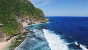 Big Ocean And Mountain Coastline Aerial Scene. Aerial footage of beautiful and wild empty beach with clean yellow sand, turquoise ocean water, big mountains and stock video footage