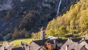 Waterfall Foroglio village rocks Ticino Switzerland aerial 4k
