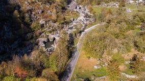 Valley autumn road rocks Ticino Switzerland Aerial 4k