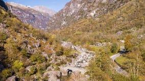 Valley autumn river rocks Ticino Switzerland Aerial 4k