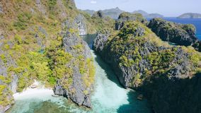 Aerial footage of big lagoon with sharp rocks and clear blue water in El-Nido, Palawan. Philippines. Unique spot on tour. A island hopping trip stock video