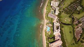 Aerial footage of blue oceanic waters,luxurious resort hyatt and beautiful nature on island maui,hawaii stock video