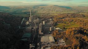 Aerial Footage of Breedon Hope Cement Works. Aerial Footage of Hope Cement Works - Hope Valley - Peak District, UK - Summer 2018 - Sunset stock video