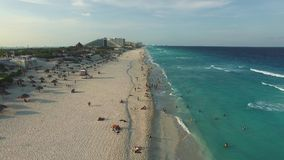 Aerial footage of Cancun beach. Drone flying above shore line with hotels stock video footage
