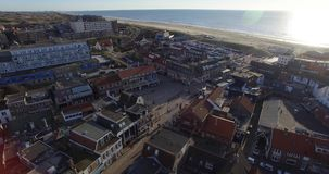 Aerial footage of the city near the sea. Drone flying above roofs of the houses in Netherlands stock video footage
