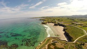 Aerial footage of coastline of Galicia - Beautiful beach in the north of Spain stock footage