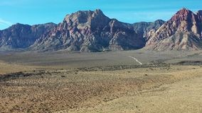 Aerial Footage of Desert and Mountains in Red Rock Canyon. Spectacular rock formations are found in Red Rock Canyon State Park just outside of Las Vegas, Nevada stock video footage
