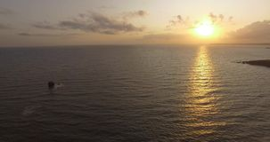 Aerial footage by drone in Cornwall waves and sea. Sunset