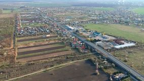 Exit road bridge on the south side of Ploiesti, Romania, aerial footage. Aerial footage from the drone of the main exit road bridge in the south side of Ploiesti stock video footage