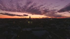 Amazing night time sunset over city. Aerial footage from drone rising over huge european city, full of evening commuter traffic, mesmerizing amazing sunset with stock footage