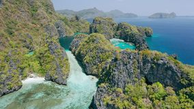 Aerial footage of entrance into big lagoon in El-Nido, Palawan. Philippines. White sand and shallow blue water unique. Spot on tour A stock video