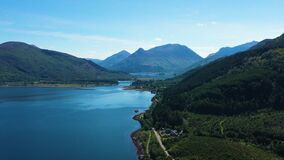 Aerial footage of the entrance to glencoe in summer in scotland