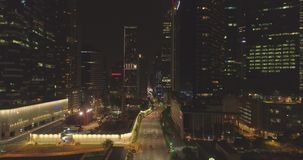 Night streets of business part of Singapore. Aerial footage Famous building in Singapore at night stock footage