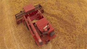Aerial footage fly over of harvester stock footage