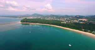 Aerial footage. Flying close over tropical sandy beach and yachts. Thailand. Phuket. Layan beach. 4K. Aerial footage. Flying close over tropical sandy beach and stock footage