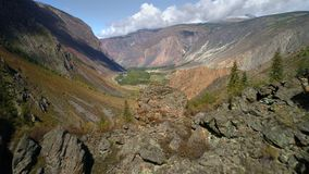 Aerial footage. Flying over a mountain ridge and valley. Rocky terrain. Cliff stock video