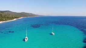 Aerial footage of flying over sail boats in spectacular adriatic bay. stock video footage