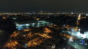 Aerial Footage Flying Towards Philadelphia PA Skyline at Night stock video footage