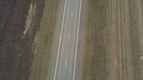 Freight truck transporting goods on a highway. Aerial footage of a freight truck transporting goods on a highway stock video
