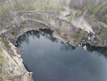 Aerial footage of granite quarry mining in forest Royalty Free Stock Images