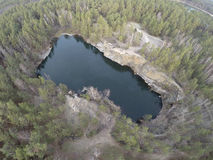 Aerial footage of granite quarry mining in forest Royalty Free Stock Photography