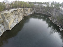 Aerial footage of granite quarry mining in forest Royalty Free Stock Photos