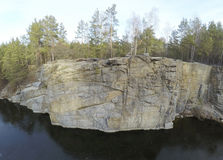 Aerial footage of granite quarry mining in forest Stock Images