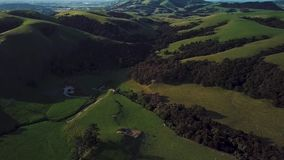 Green hills in Martinborough. An aerial footage of green hills and a river in a valley, Martinborough, New Zealand stock video footage
