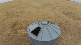 Aerial footage of harvest silo stock video