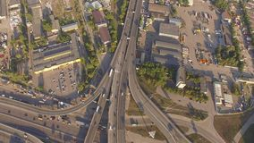 Aerial footage of highway and overpass with cars and trucks. stock video footage