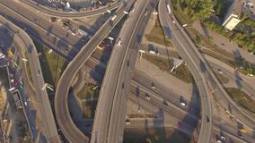 Aerial footage of highway and overpass with cars and trucks. stock footage
