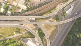Aerial footage of highway and overpass with cars and trucks. stock video