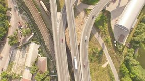 Aerial footage of highway and overpass with cars and trucks. Aerial footage of highway and overpass with cars, trucks and mooving train. Smooth video from drone stock video