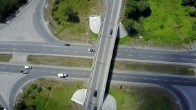 Aerial Footage of Highway and Overpass Urban Life with cars and trucks. The sun is shining stock footage