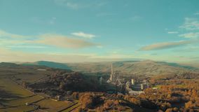 Aerial Footage of Breedon Hope Cement Works. Aerial Footage of Hope Cement Works - Hope Valley - Peak District, UK - Summer 2018 - Sunset stock video footage