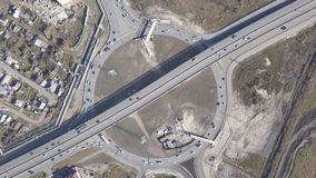 A huge roundabout full of cars and trucks