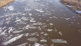 The ice floes floating on the river. The ice drift in spring time. Aerial footage of the ice drift in spring time. The ice floes floating on the river stock video