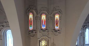 Aerial footage inside the Orthodox Church. Drone view of stained glass stock video footage
