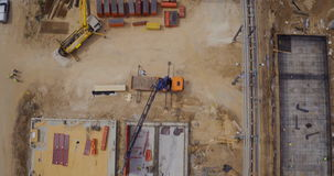 Aerial footage of a large construction site stock video footage