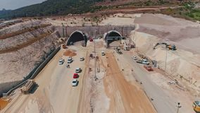 Aerial footage of large highway construction project with tunnels and bridges. Aerial footage of a large scale highway construction project stock footage