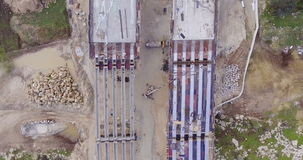 Aerial footage of a large highway construction site stock video footage