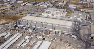 Aerial footage of a large industrial complex stock video footage