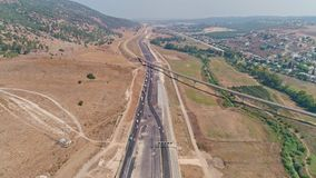 Aerial footage of large highway construction project with tunnels and bridges. Aerial footage of a large scale highway construction project stock video