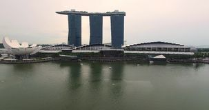 Aerial footage of Marina Bay Sands, flight above water and bay stock video footage