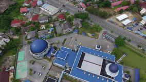Aerial footage of a mosque. Aerial footage of Sultan Ismail Petra mosque in the center of Kubang Kerian town located in Kota Bharu, Kelantan, Malaysia stock video