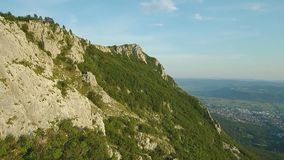 Aerial footage of Mountain gora above Vipava valley covered with forest.  stock video footage