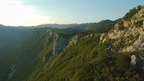 Aerial footage of Mountain gora above Vipava valley covered with forest.  stock footage