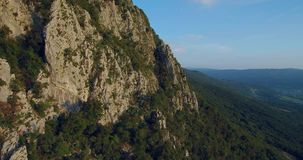 Aerial footage of Mountain Nanos above Vipava valley covered with forest stock footage
