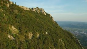 Aerial footage of Mountain range Gora above Vipava valley covered with forest.  stock video