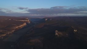 Mountain valley at sunset. Aerial footage mountain valley at sunset stock video footage